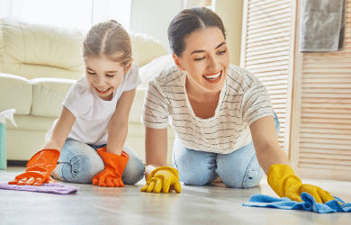 mother and daughter cleaning together