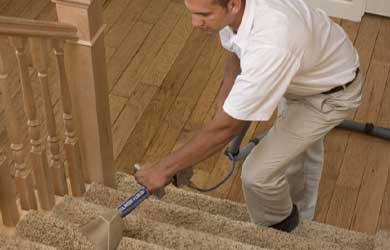 Chem-Dry technician cleans carpeted stairs