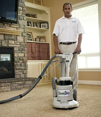 chem-dry technician cleaning carpet