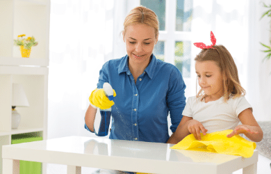 woman and daughter cleaning together