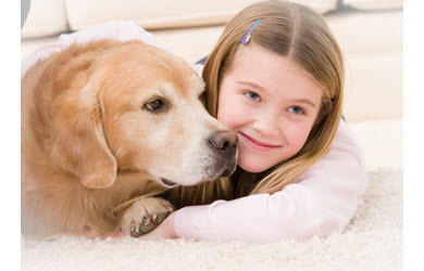 dog and girl on rug