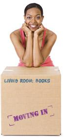 Woman leaning on moving boxes